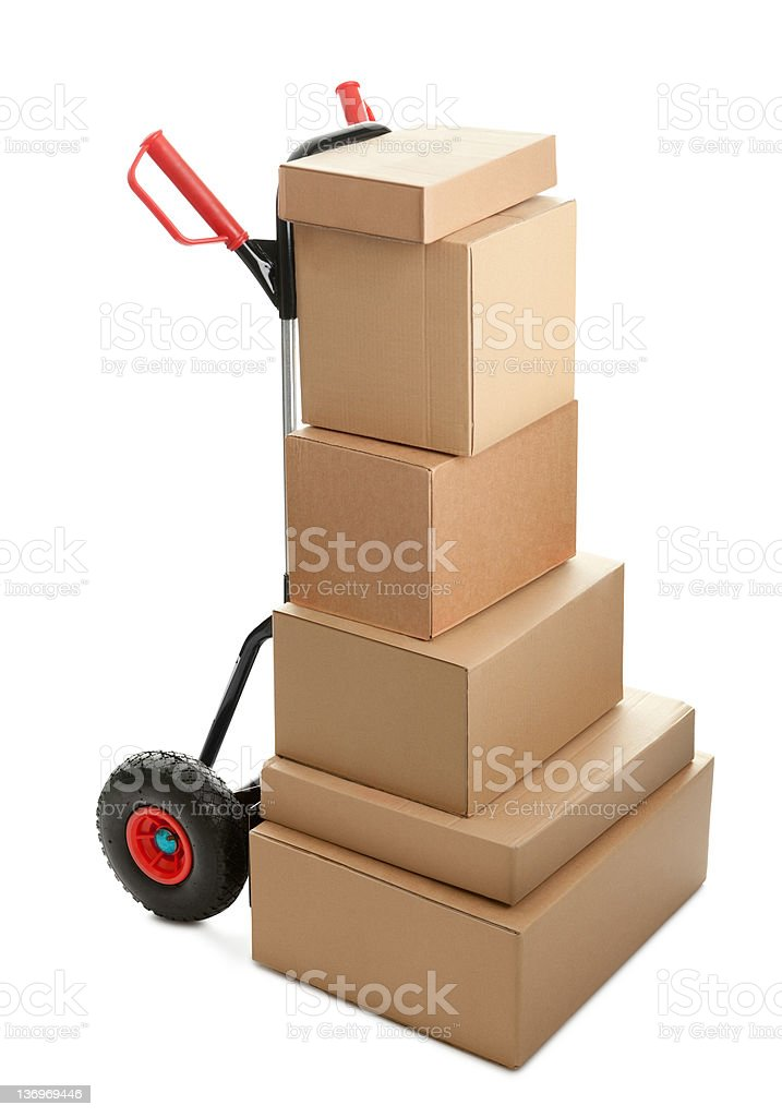 Large dolly with brown shipping boxes royalty-free stock photo