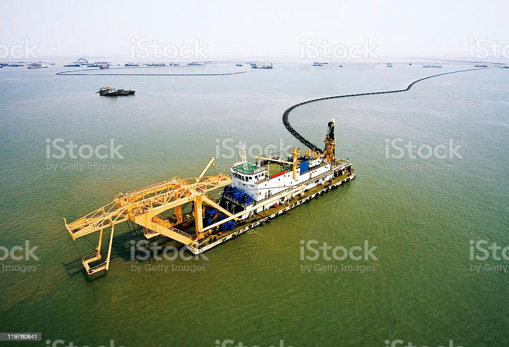 Large dredger in the middle of a body of water stock photo