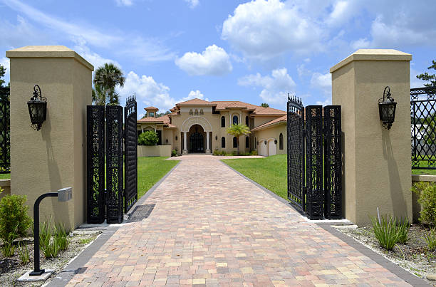 large driveway and gate to florida home - open gate stock photos and pictures