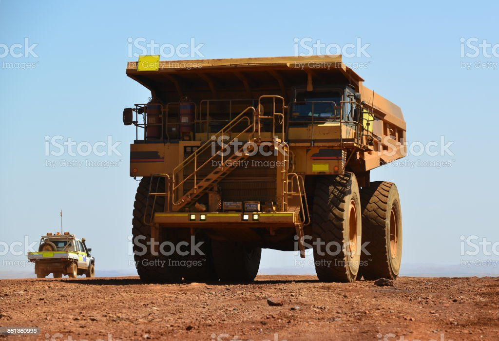Large dump truck and small light vehicle. stock photo