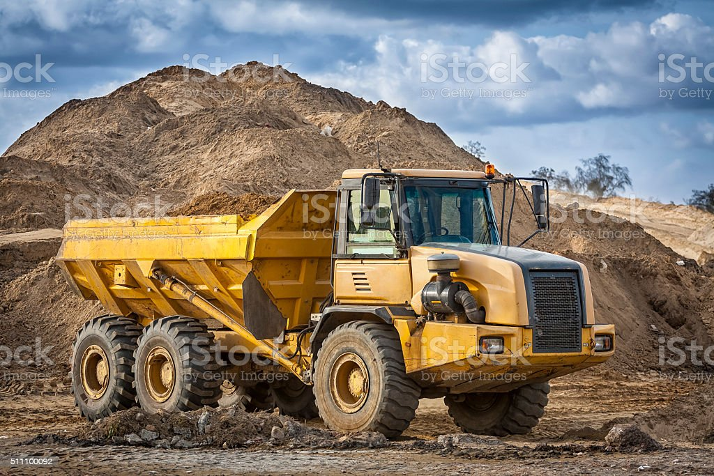 Large dump truck in construction site stock photo