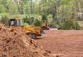istock Large earth mover digger clearing land 177774788