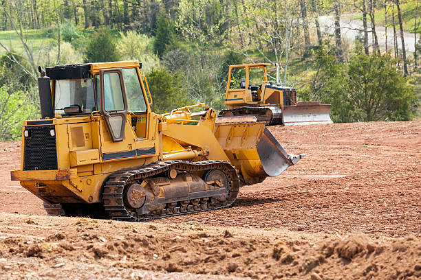 Large earth mover digger clearing land stock photo