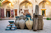 Large earthenware jugs in inner yard of old center of Bukhara, Uzbebkistan.