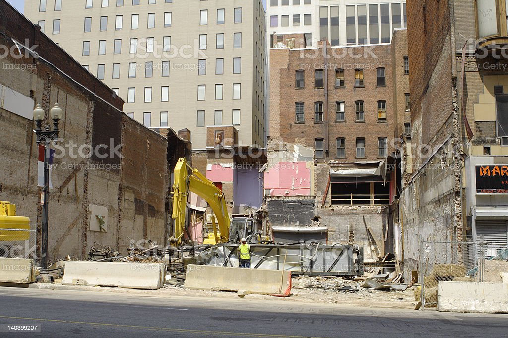 Large Earthmover Moving Scrap Metal at Demolition Site City royalty-free stock photo