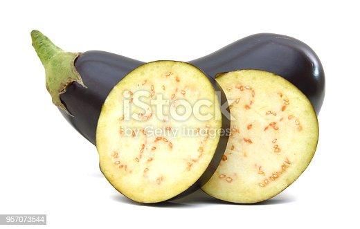 istock large eggplants and  sliced  on white background. 957073544