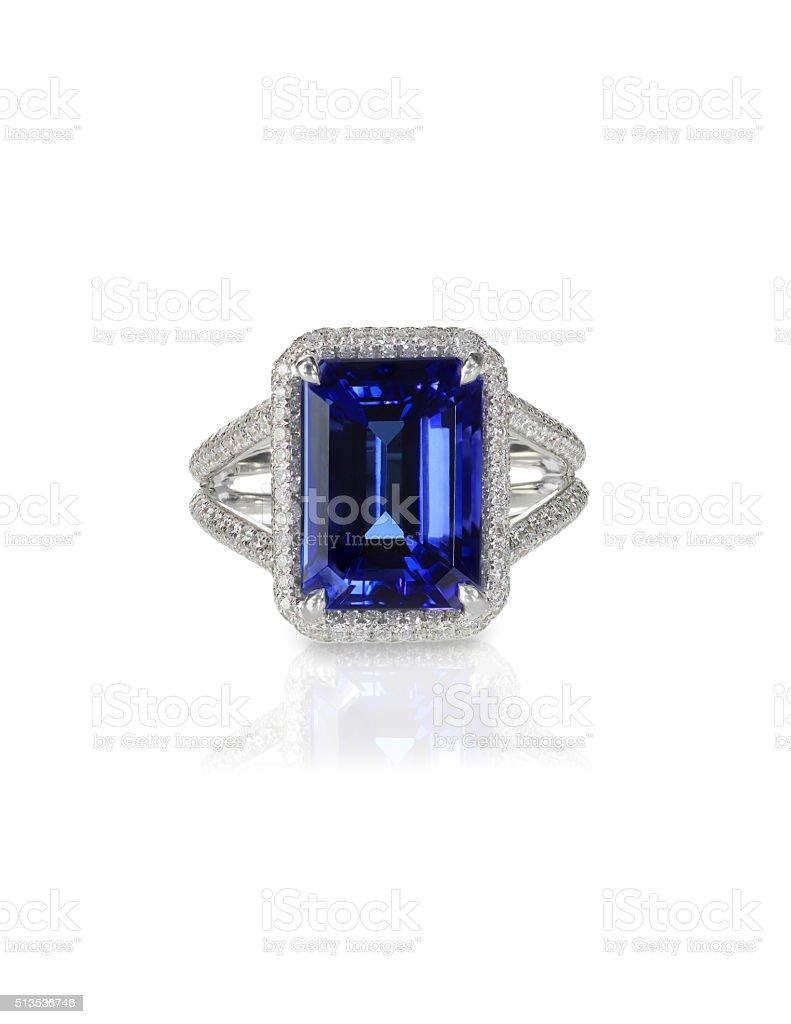 Large emerald cut sapphire engagement ring halo setting pave diamonds stock photo