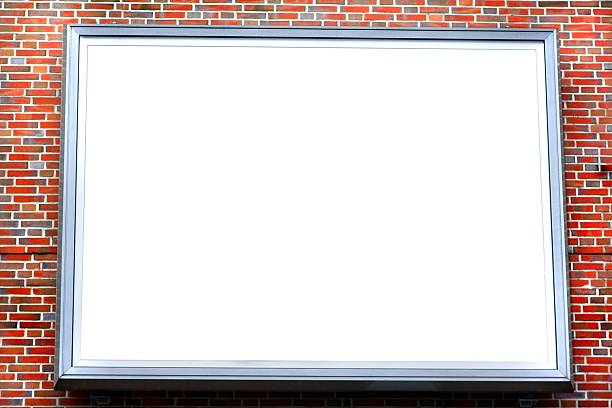 large empty billboard on a red brick stone wall large empty billboard on a red brick stone wall electronic billboard stock pictures, royalty-free photos & images