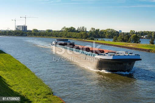 istock Large empty freightship in the Amsterdam - Rhine Canal 614709502