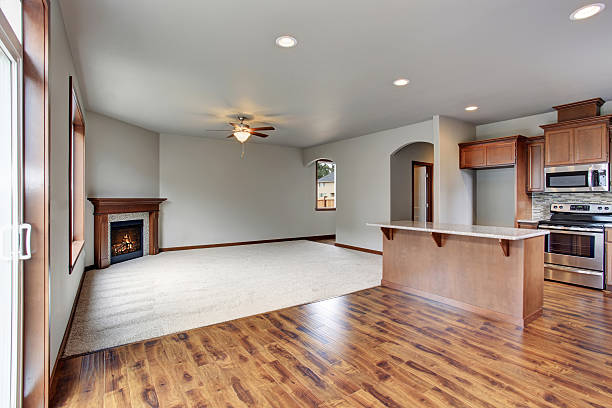 Large empty living room interior connected with kitchen room. - Photo
