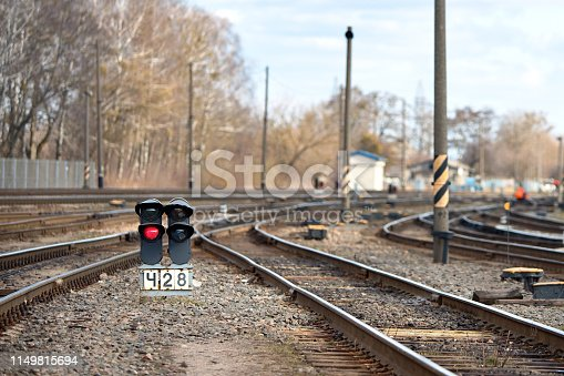Large empty railroad fork semaphore. Concept of industrial logistic and transportation background with selected focus on lantern with copy space.