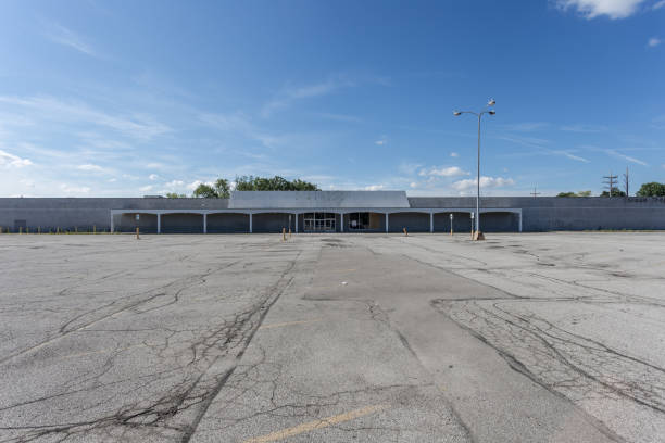 Large empty storefront and empty parking lot stock photo
