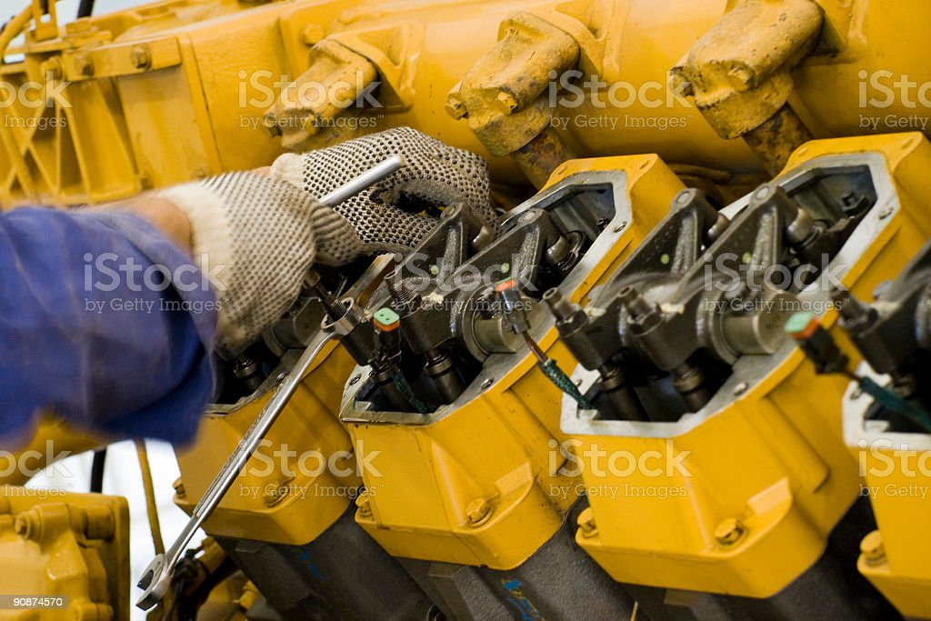 Large engine maintenance being performed stock photo