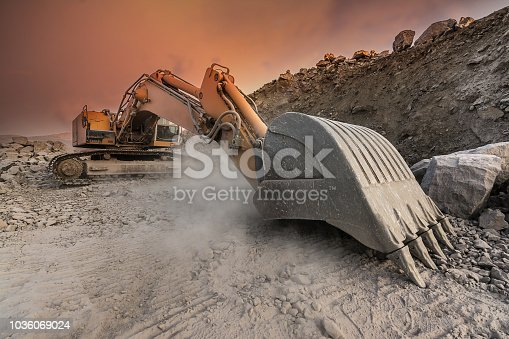 Heavy machinery to work in an open pit mine