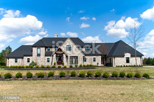 A large new executive brick house on a bright spring day.Similar Images: