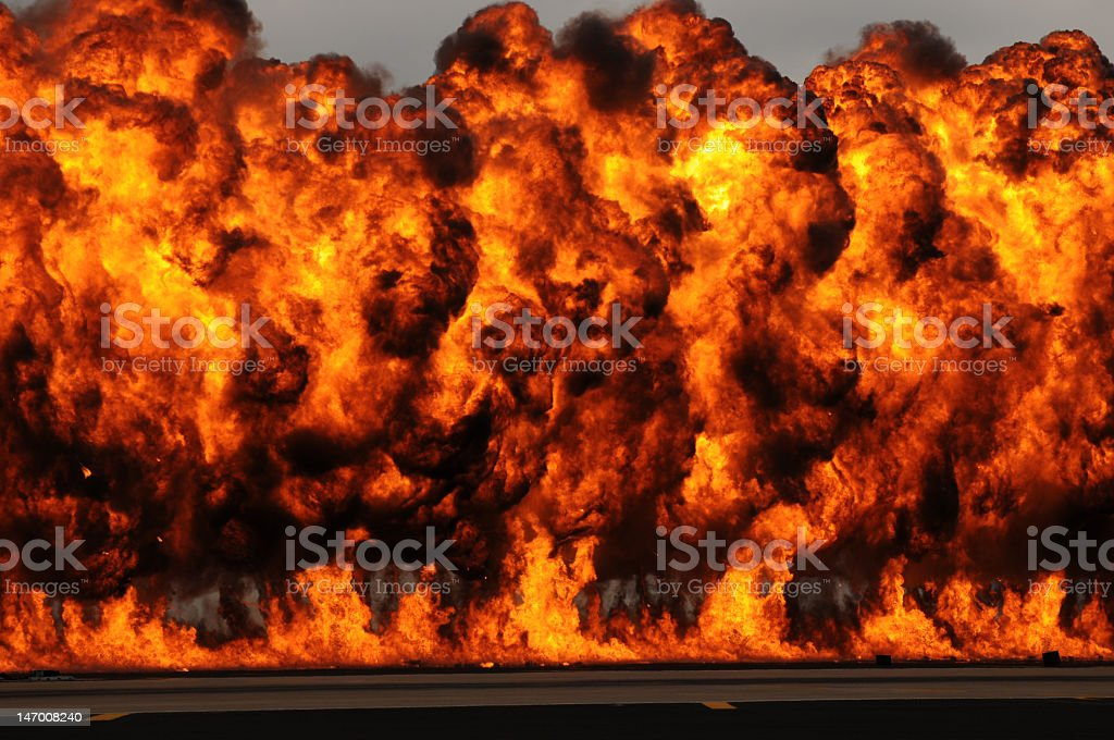 Large explosion with massive orange flames in the sky royalty-free stock photo