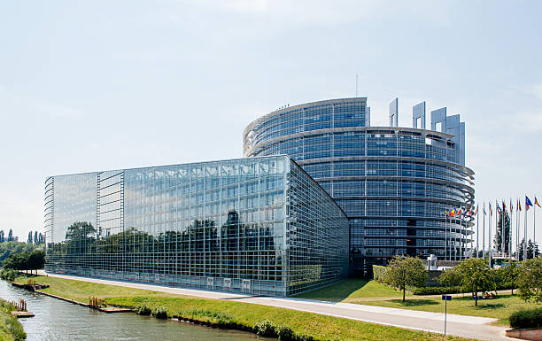 Large facade of the European Parliament in Strasbourg Strasbourg, France - June 29, 2016: Large facade of the European Parliament in Strasbourg, France on June 29,  2010. The European Parliament (or EU Parliament or the EP) is the directly elected parliamentary institution of the European Union (EU) strasbourg stock pictures, royalty-free photos & images