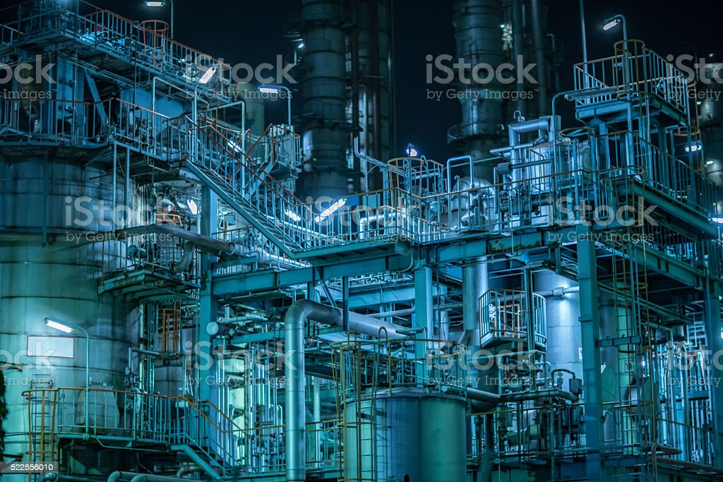 Large factory detail at night stock photo