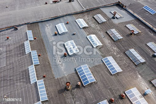 large factory roof. warehouse building in an industrial estate. birds eye view