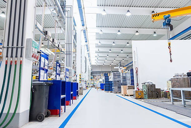large factory with equipment - metal robot in logistic factory foto e immagini stock