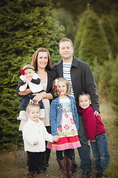 Large family Christmas Card photo in Christmas Tree Farm stock photo