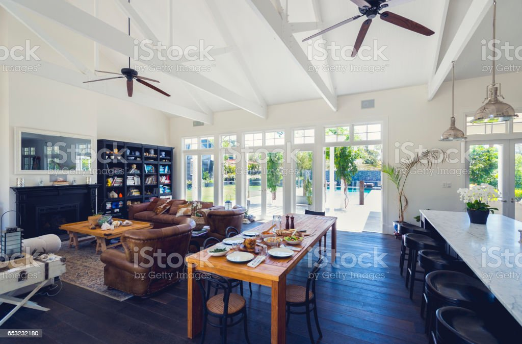 Large family home with a meal on the dining table. stock photo