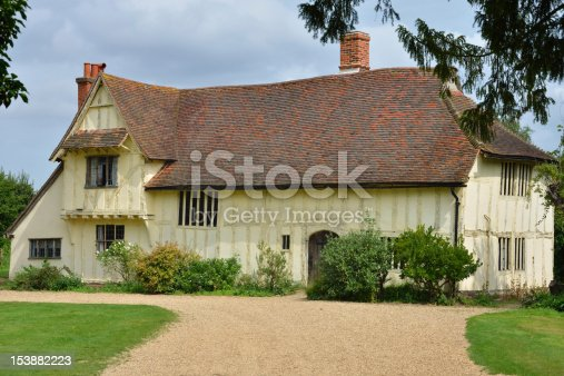istock Large farmhouse at flatford 153882223