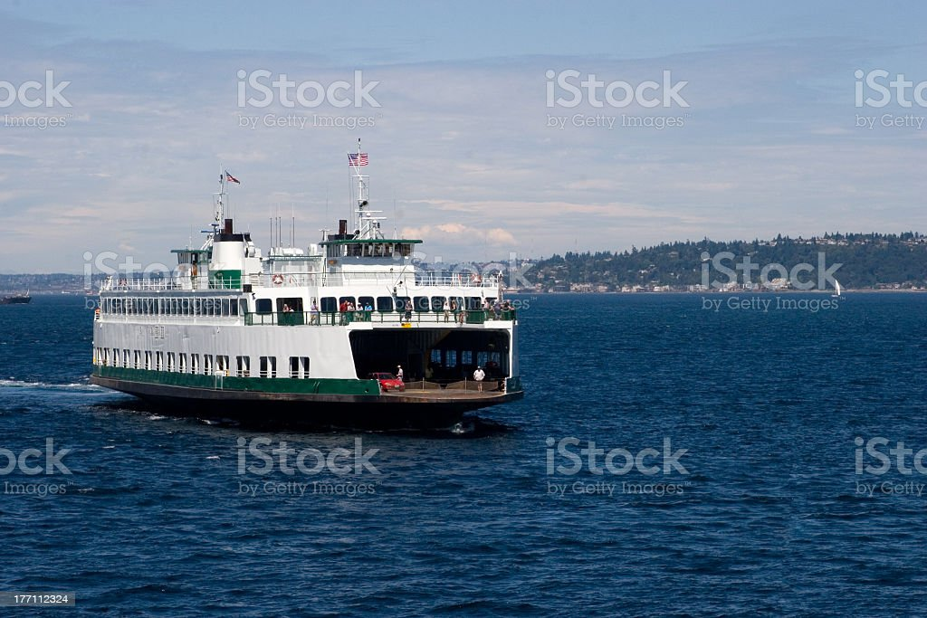 A large ferry boat sailing in a lake stock photo