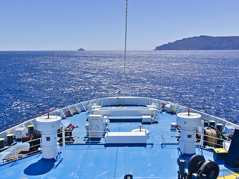 Large ferryboat ship  bow with equipment while sailing in Aegean sea, Greece.