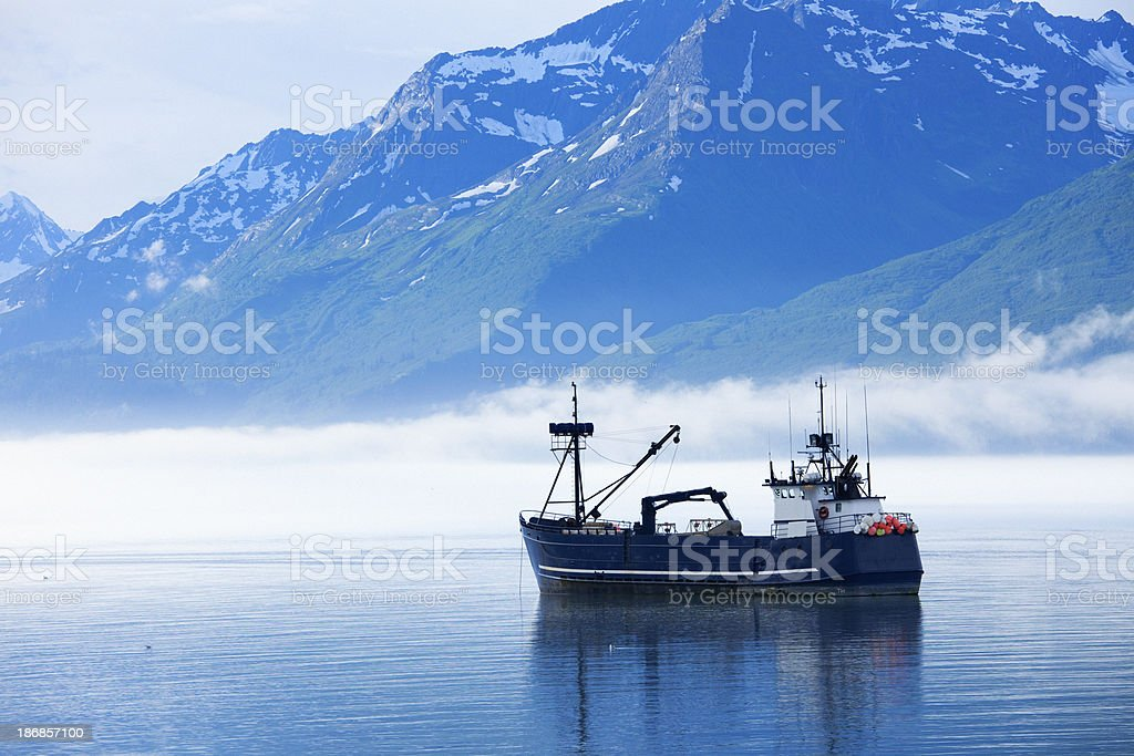 Large fishing boat anchored in Valdez, Alaska bay stock photo