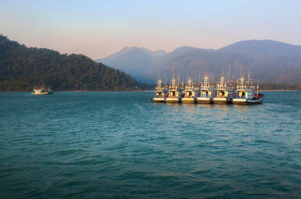 Large fishing boats are sailing in the sea to catch fish at Koh Chang, Thailand Large fishing boats are sailing in the sea to catch fish at Koh Chang, Thailand koh chang stock pictures, royalty-free photos & images