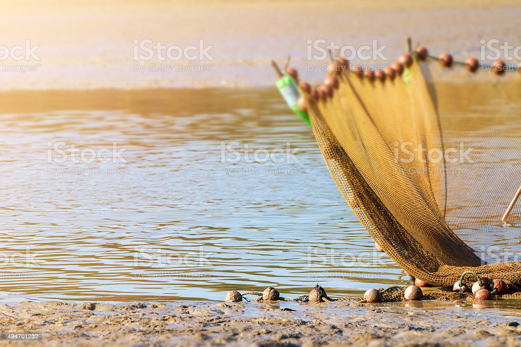 Large fishing net planted in middle of pond of Dombes stock photo