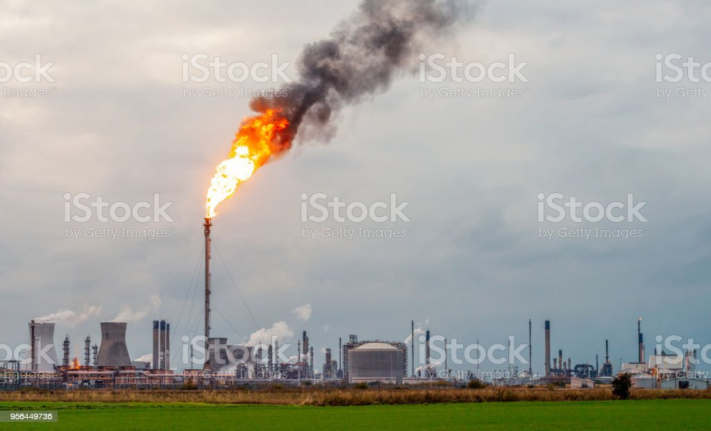 Large Flare Stack Flame At Petrochemical Plant Stock Photo