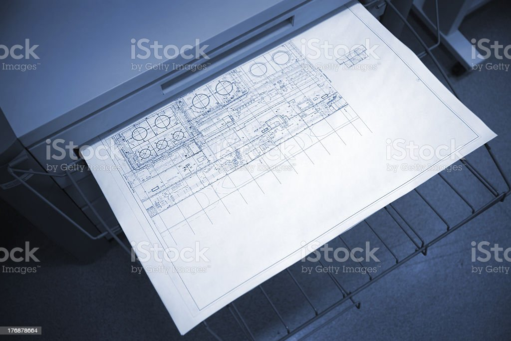 Black & white wide-format plotter printing out some architectural...