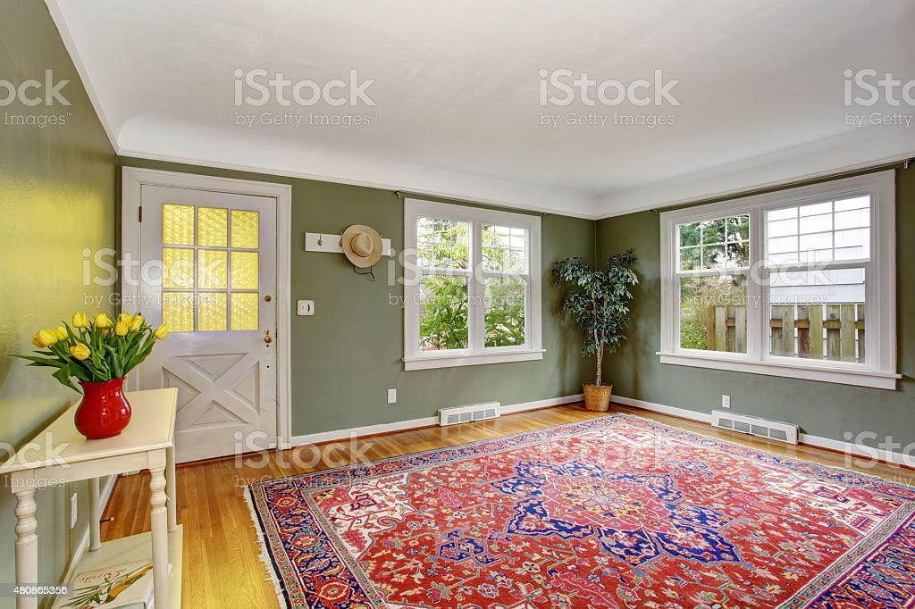 Large front room with chic decor and green walls. stock photo