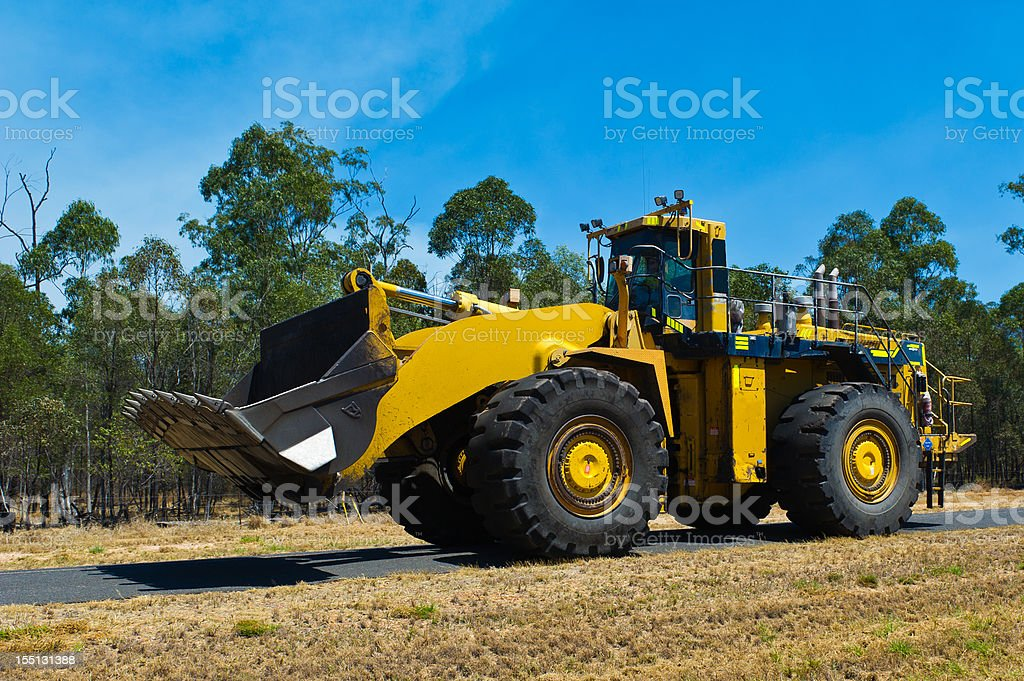 Large Frontendloader Digger on Mining road stock photo