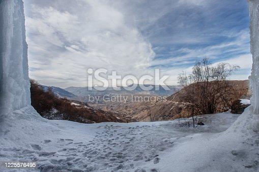 A large frozen waterfall. 3 cascading waterfall in Dagestan, Russia.