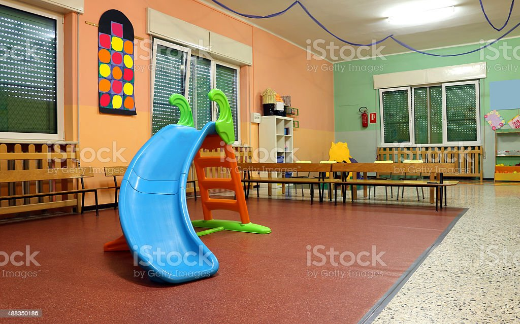 Large game room in a nursery with the plastic slide stock photo