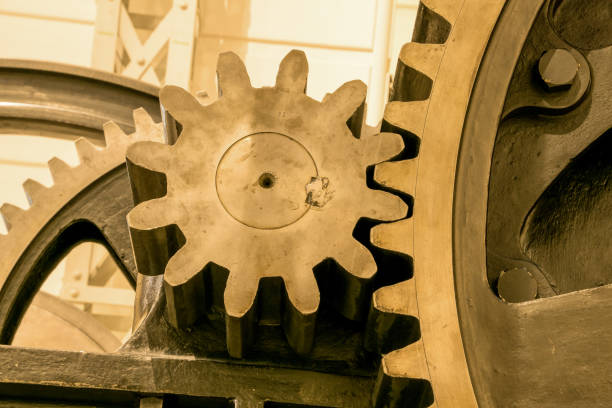 large gears interlock - industrial revolution stock pictures, royalty-free photos & images