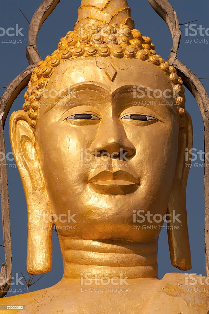Large golden buddha head buddhist culture and life style temple stock photo