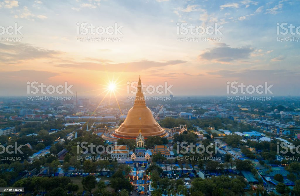 Large golden pagoda Located in the community at sunset , Phra Pathom Chedi , Nakhon Pathom , Thailand . stock photo