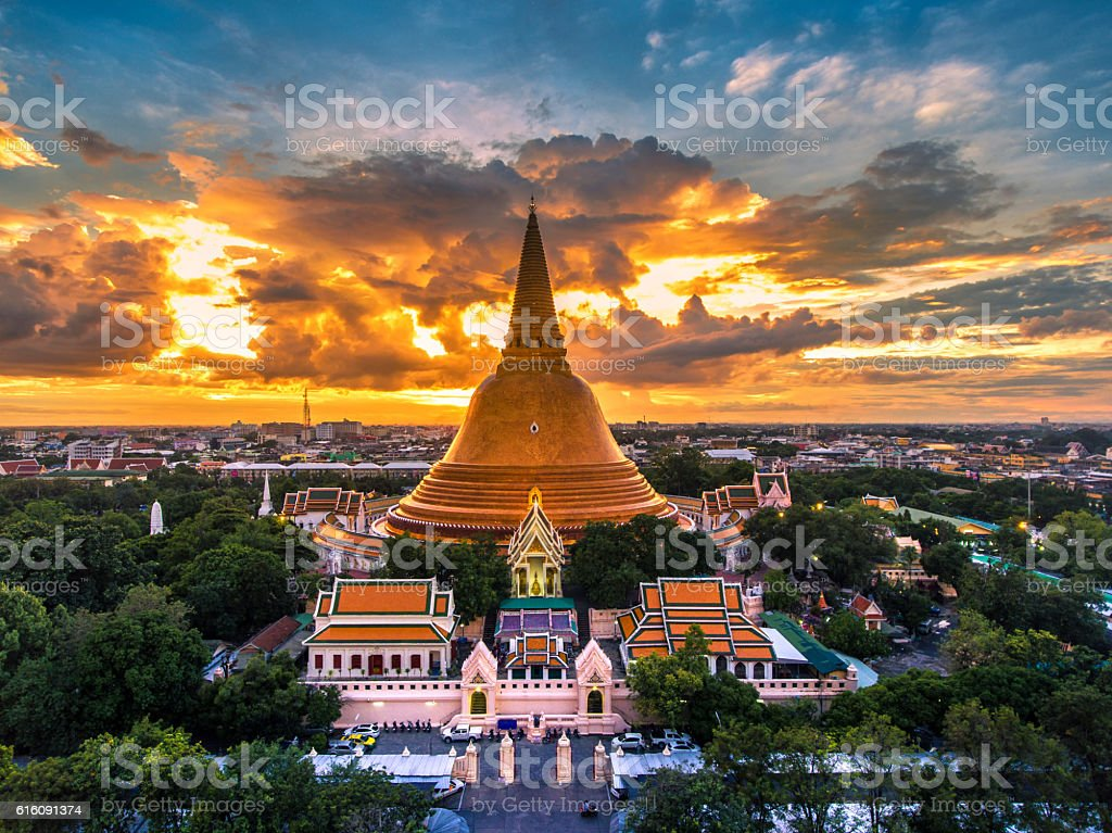 Large golden pagoda Located in the community at sunset , stock photo