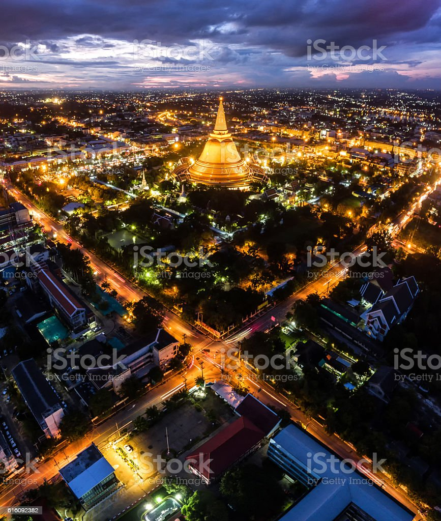 Large golden pagoda Located in the community at sunset stock photo