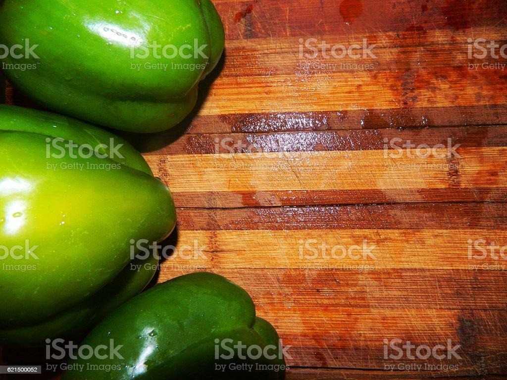 large green peppers on a wooden board Lizenzfreies stock-foto