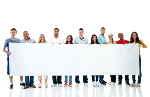istock Large group holding a big white board. 184336052