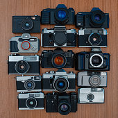 Large group of 35mm vintage film cameras lying in arrangement close to each other