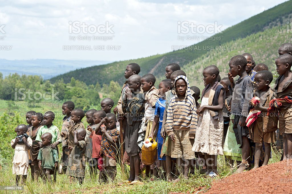 Large group of african children in a field, Burundi stock photo