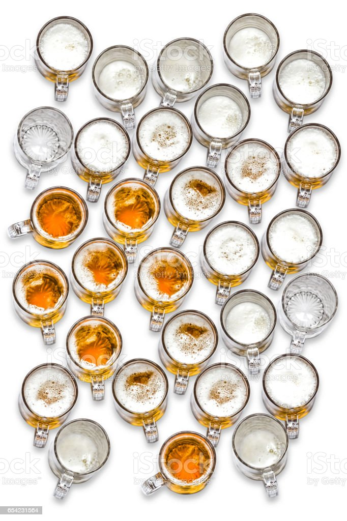 large group of beer glasses seen from top on white background stock photo