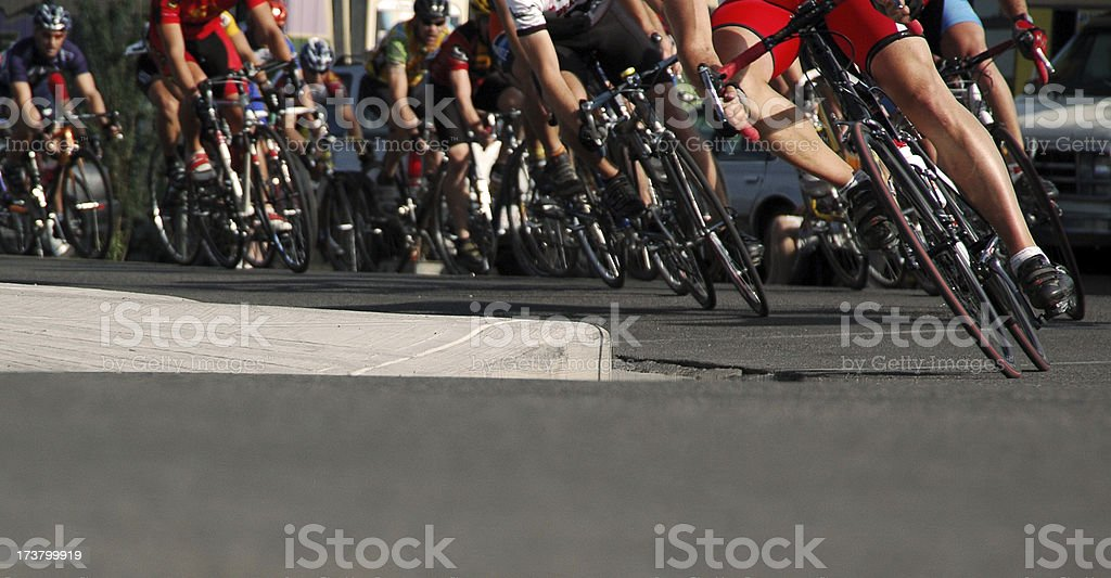 A large group of bicycles in a road race stock photo
