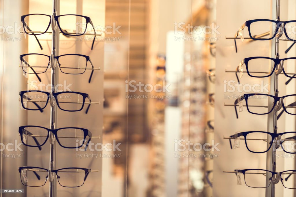Large group of black eyeglasses at optician store. stock photo